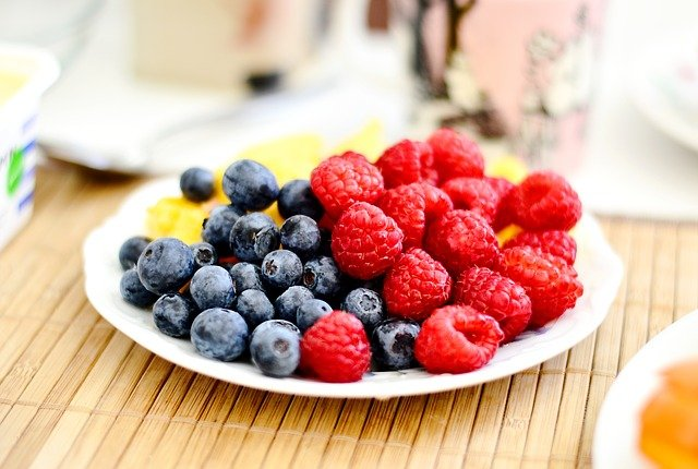 A close up of a plate of fruit sitting on a table